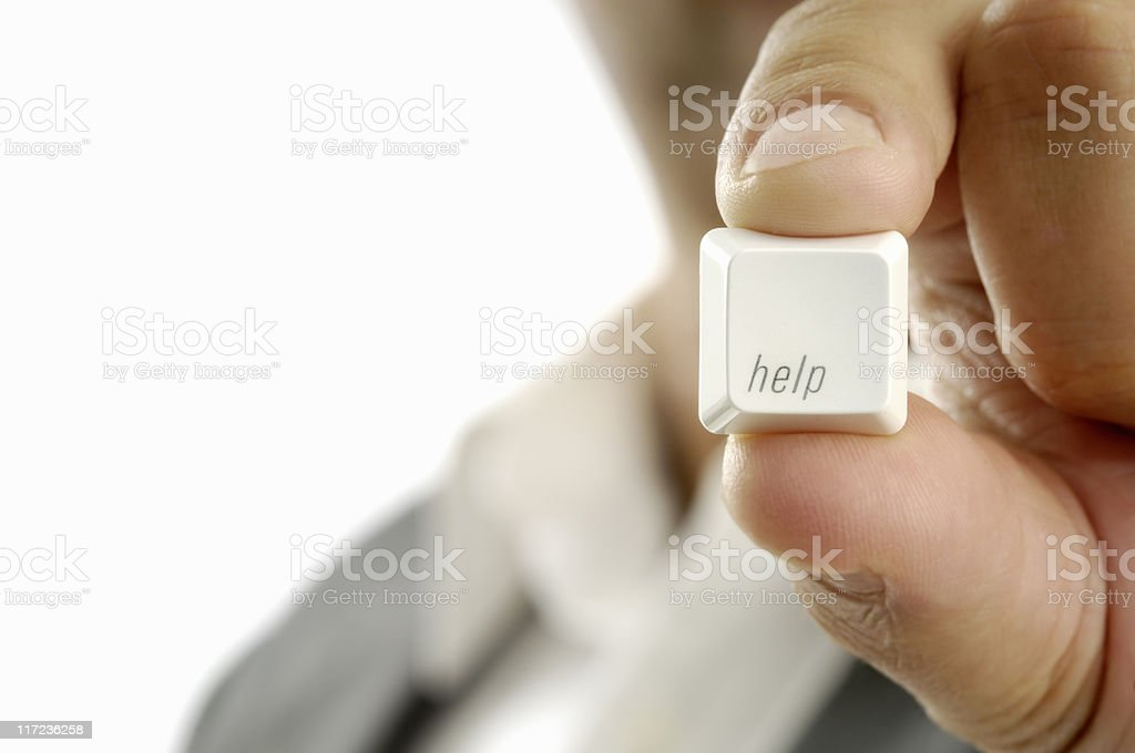 Man in suit holding up a help key royalty-free stock photo