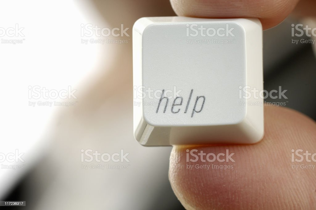Man in suit holding-up a help key royalty-free stock photo