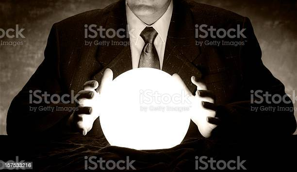 Man in suit holds hands over glowing crystal ball picture id157533216?b=1&k=6&m=157533216&s=612x612&h=aq5txulmbyhroriagmjupe2rm0qz84kzhno i6atunk=