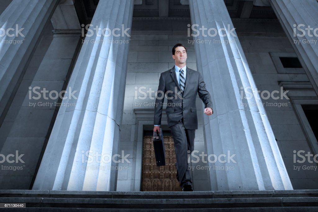 Man In Suit Leaving Courthouse stock photo