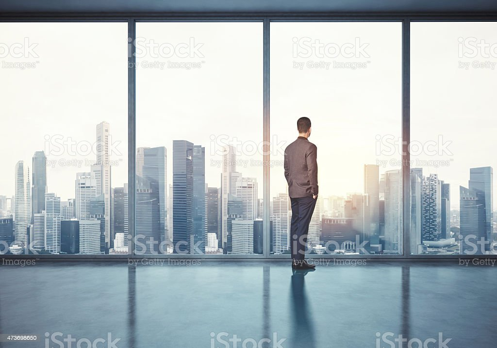 Man in suit looking at sunrise. 3d render stock photo