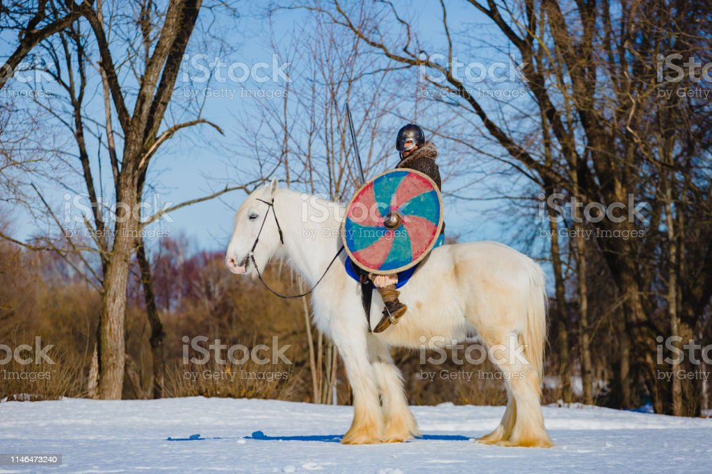 Man In Suit Of Ancient Viking Riding Big White Horse Stock Photo Download Image Now Istock