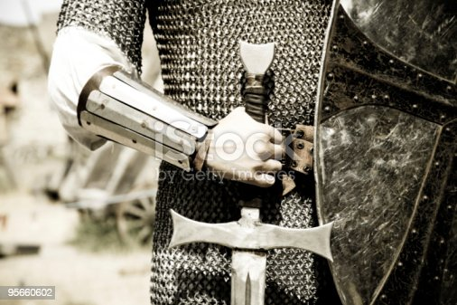 istock Man in suit of armor with medieval sword 95660602