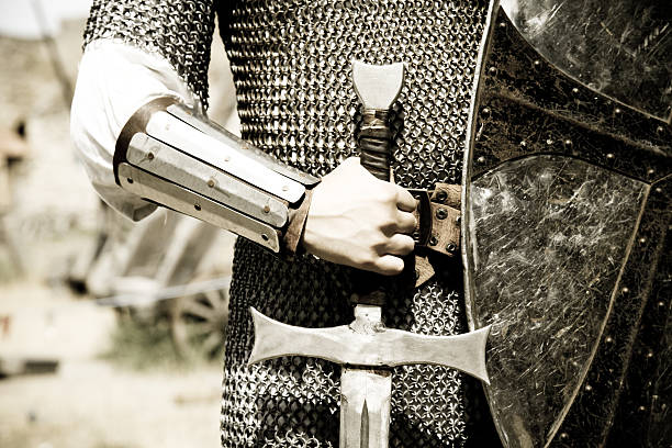 man in suit of armor with medieval sword - warrior person stock pictures, royalty-free photos & images