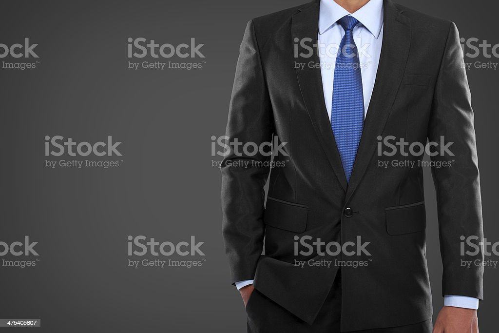 man in suit on a black background stock photo