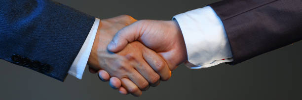 Man in suit shake hand as hello in office closeup Man in suit shake hand as hello in office closeup. Friend welcome mediation offer positive introduction greet or thanks gesture summit participate approval motivation strike arm bargain concept letterbox format stock pictures, royalty-free photos & images