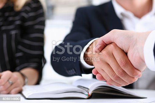 istock Man in suit shake hand as hello in office closeup 828514690