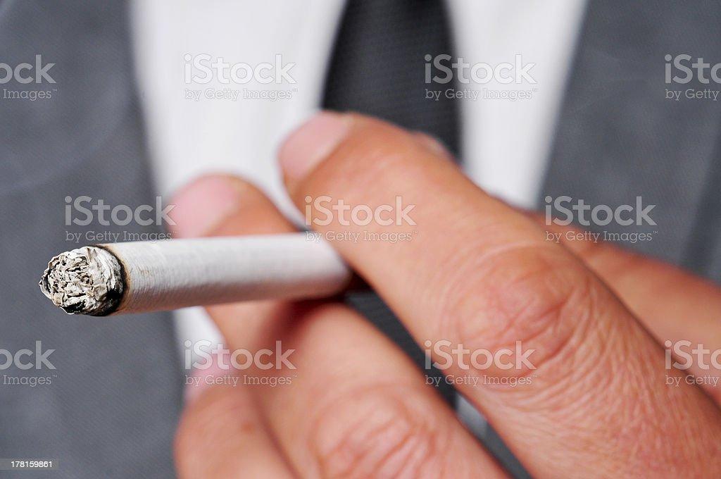man in suit smoking royalty-free stock photo