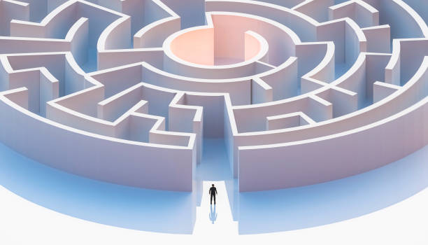 Man in suit standing in front of a circular or concentric maze entrance. Aerial. Abstract and conceptual 3d render illustration. stock photo