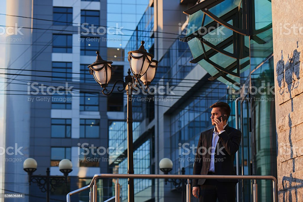 Man in suit talking on mobile phone stock photo