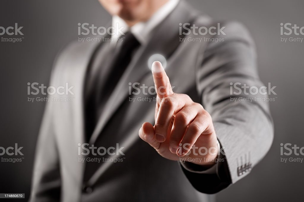 Man in suit touching the screen royalty-free stock photo