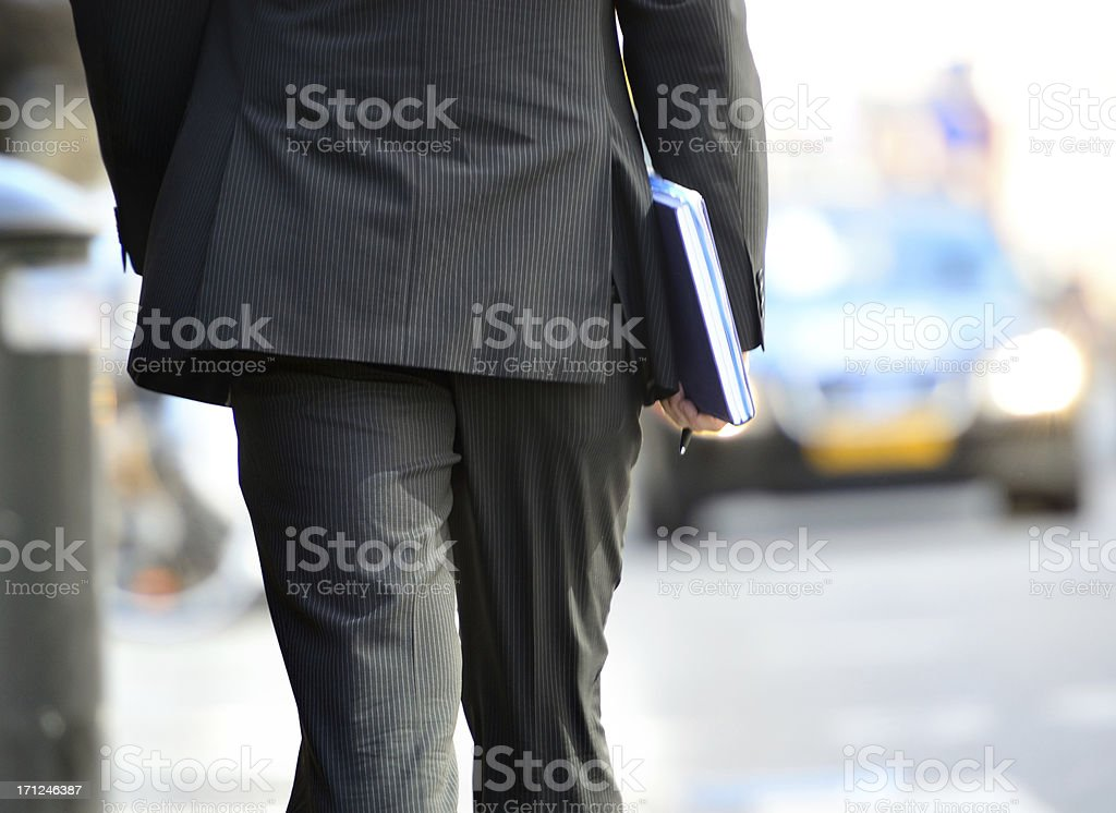 Man in suit walking towards taxi Motion blurred man walking with office items. Abstract Stock Photo