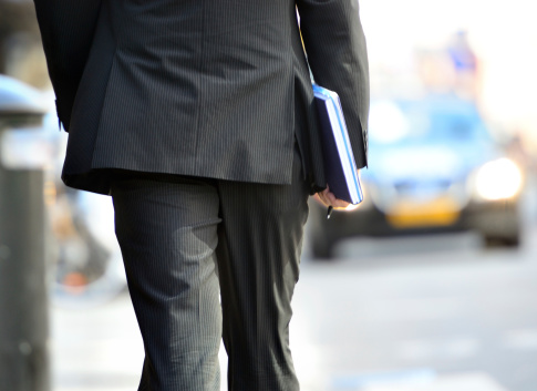 Man In Suit Walking Towards Taxi Stock Photo - Download Image Now
