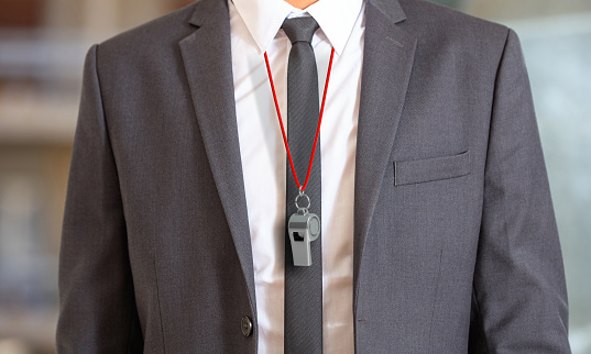 Man In Suit Wearing A Whistle With Red String 3d Illustration Stock Photo - Download Image Now