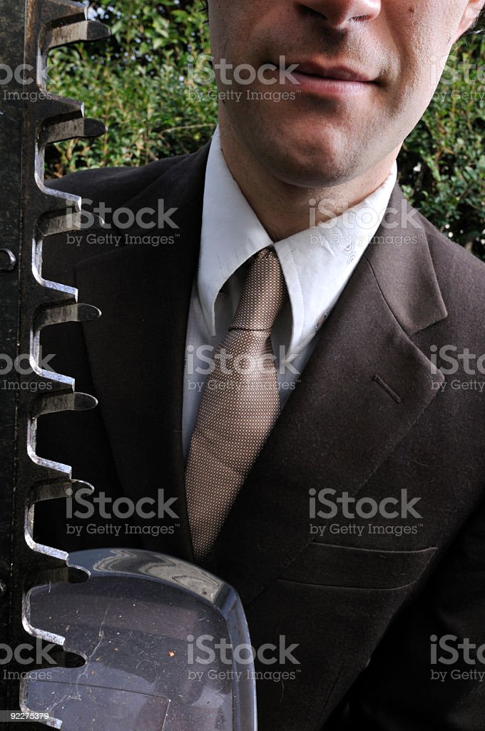 man in suit with hedge trimmer royalty-free stock photo