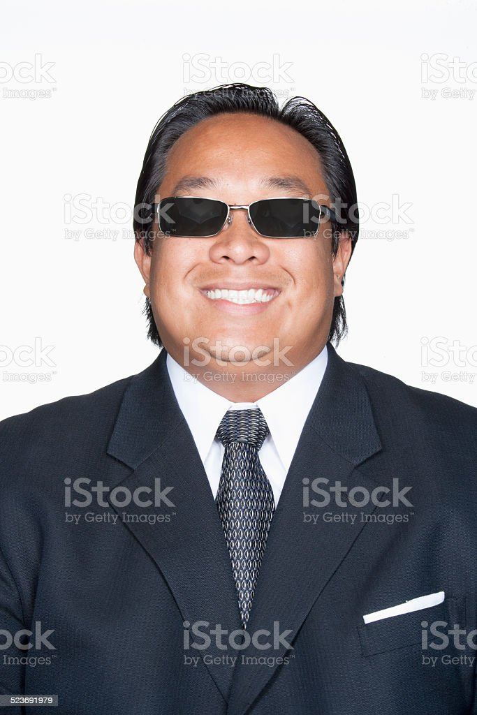 Man in suit with sunglasses smiling stock photo