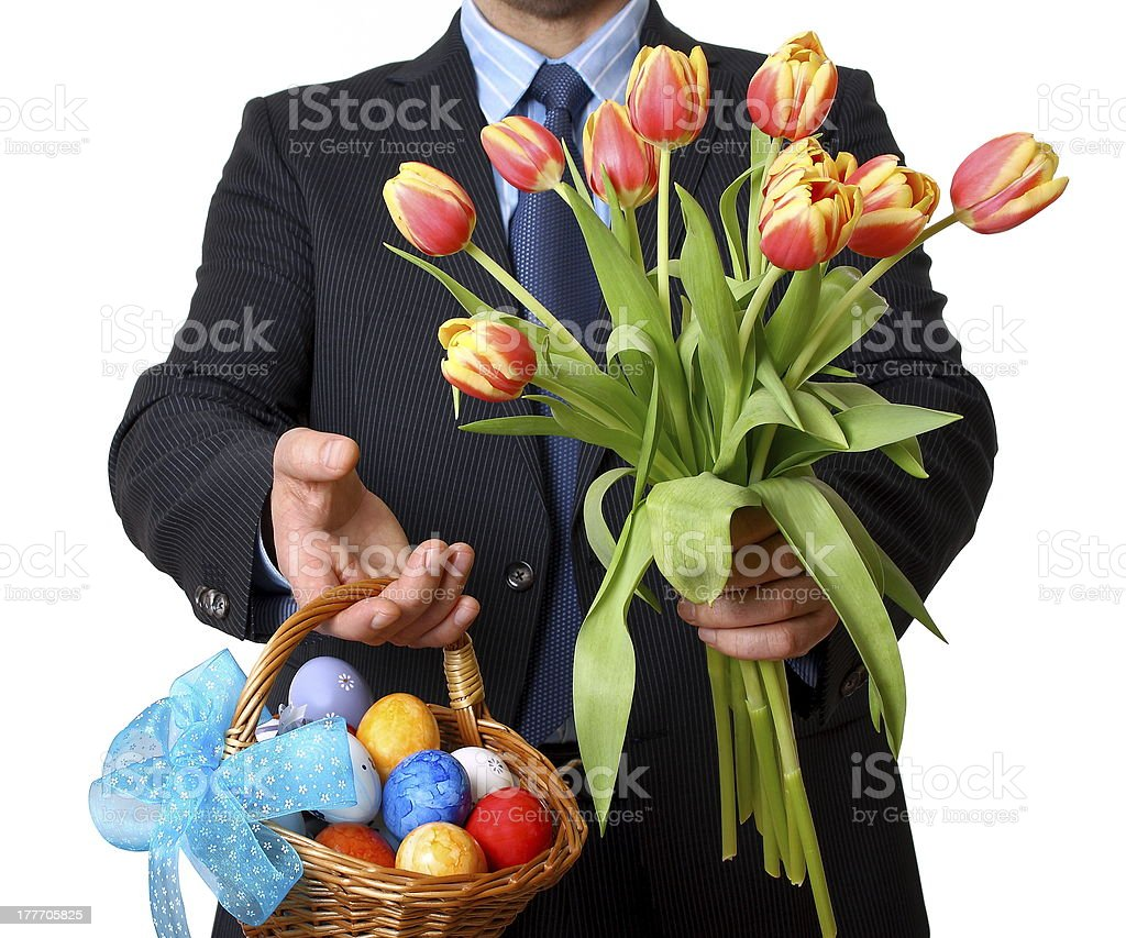 Man in suit with tie gives tulips and easter basket stock photo man in suit with tie gives tulips and easter basket royalty free stock photo negle Choice Image