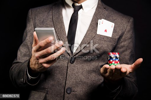 istock Man in suit with to aces in pocket, online poker 656362370