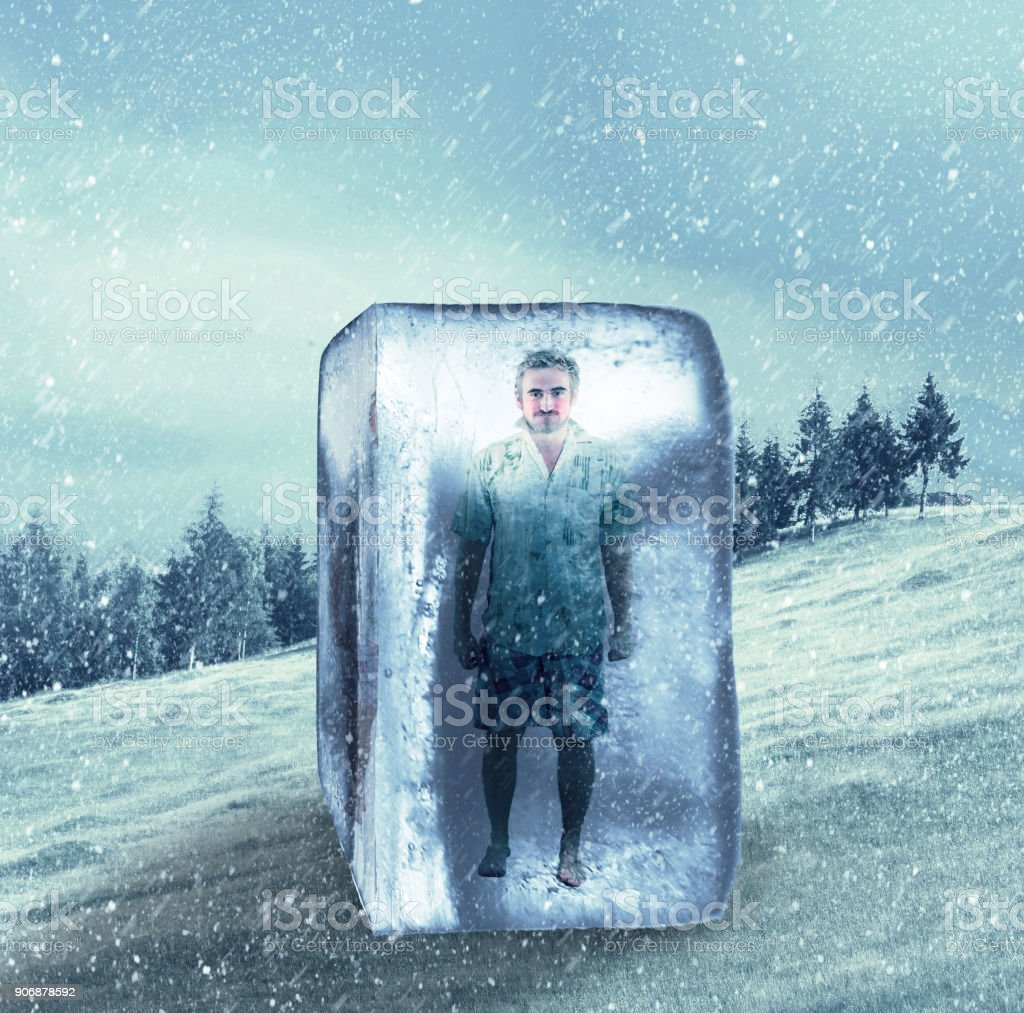 man in summer clothes frozen in an ice cube stock photo more