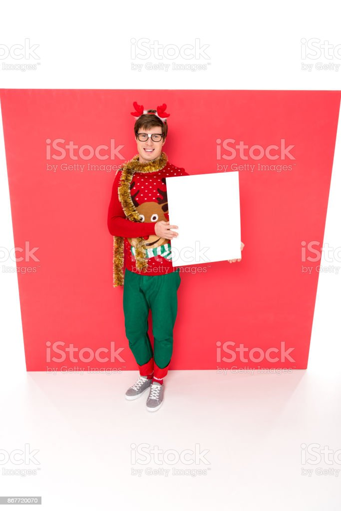 man in sweater with blank banner stock photo