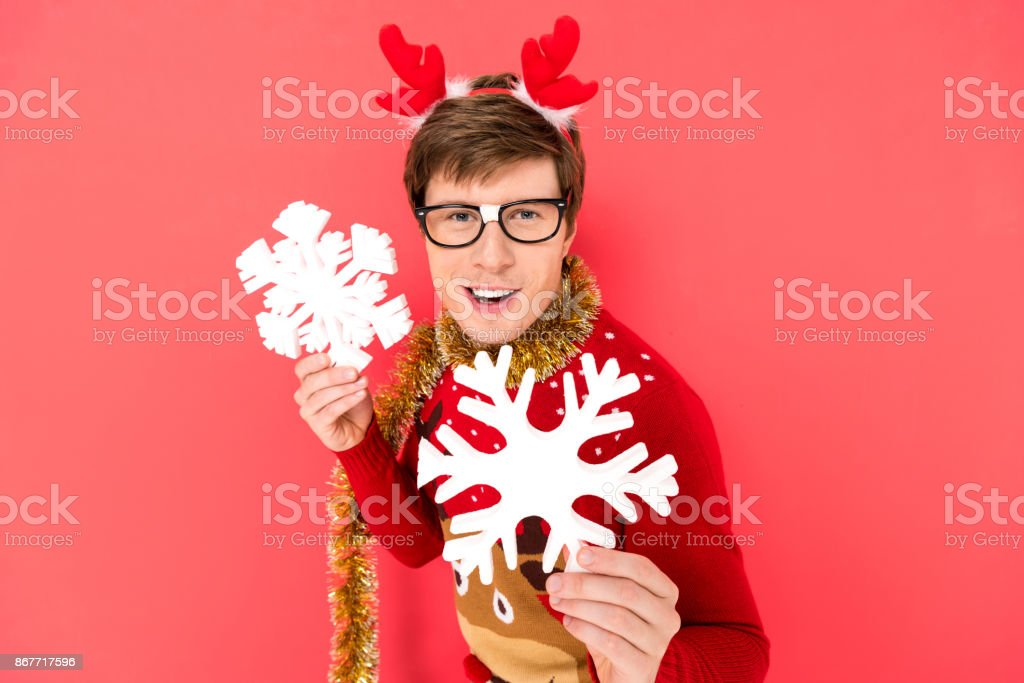 man in sweater with decorative snowflakes stock photo