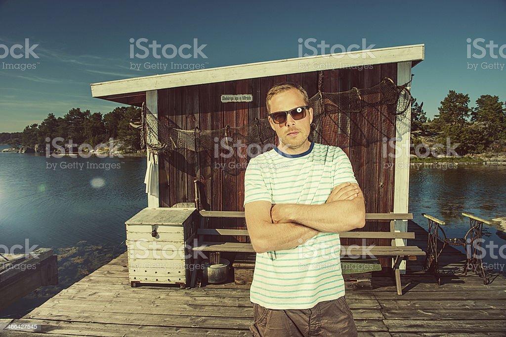 Man in swedish archipelago stock photo