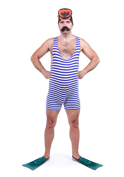 Man in swim dress standing with hands on hips Man in swim dress standing with hands on hips swimwear stock pictures, royalty-free photos & images