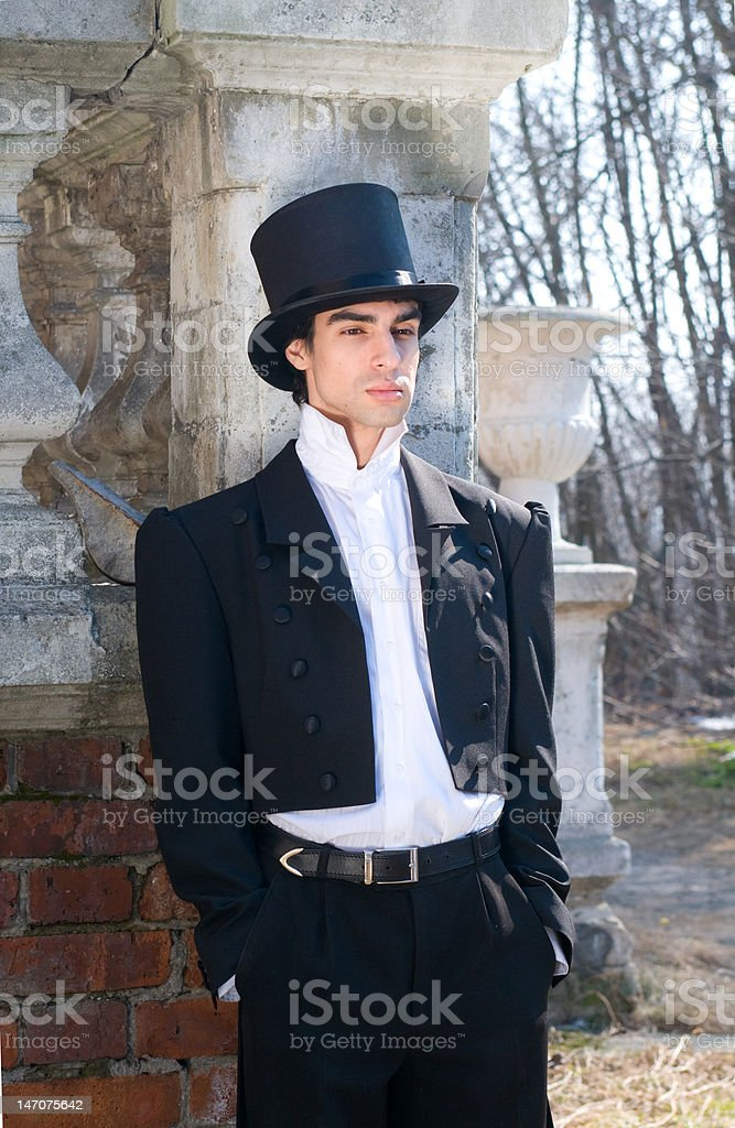 man in the black tailcoat and top hat stock photo