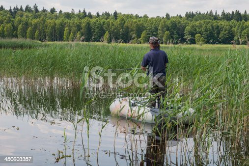 115874504istockphoto man in the boat 450603357