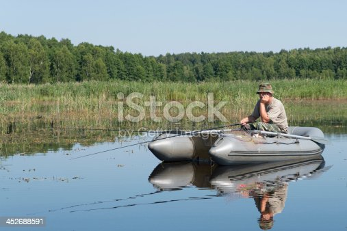 115874504istockphoto man in the boat 452688591