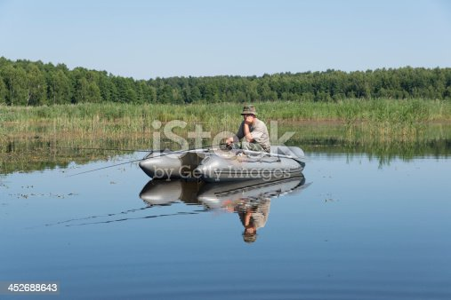 115874504istockphoto man in the boat 452688643