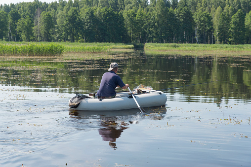 115874504 istock photo man in the boat 471776249