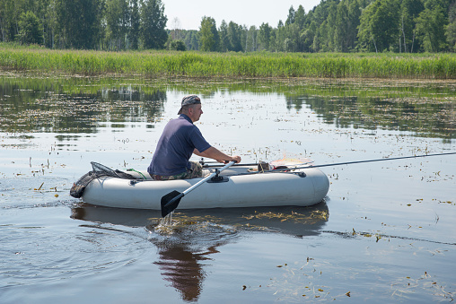 115874504 istock photo man in the boat 471776277