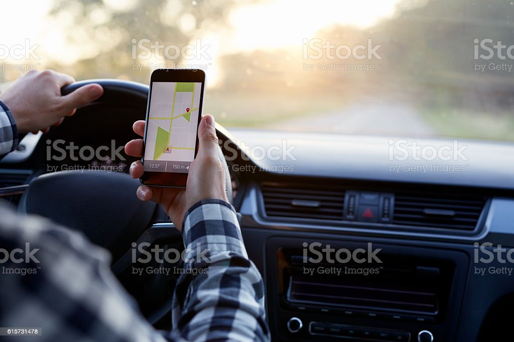 Man in the car holding mobile phone stock photo
