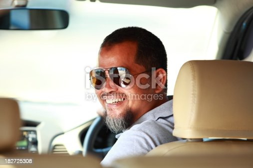 1051147634 istock photo man in the car 182725308