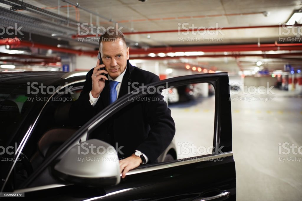 Man in the car stock photo