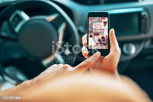 501071464 istock photo man in the car using the contact tracing app 1227321604