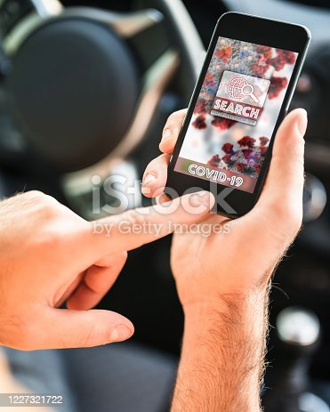 501071464 istock photo man in the car using the contact tracing app 1227321722