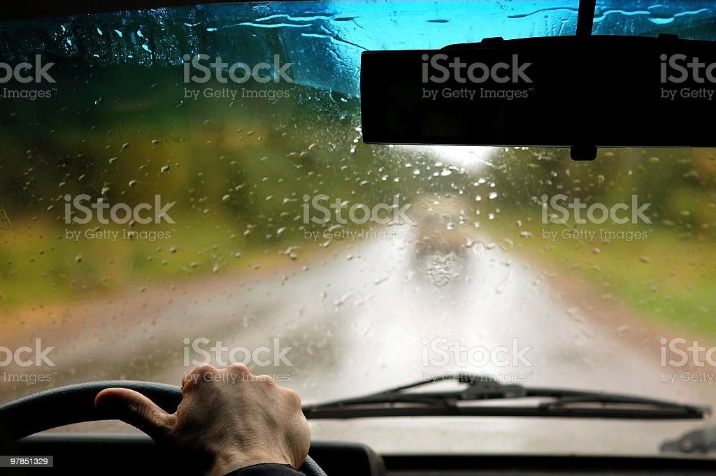 Man in the car when rain is going royalty-free stock photo