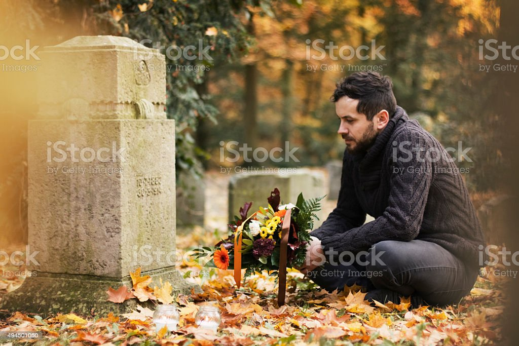 Man in the cemetery stock photo