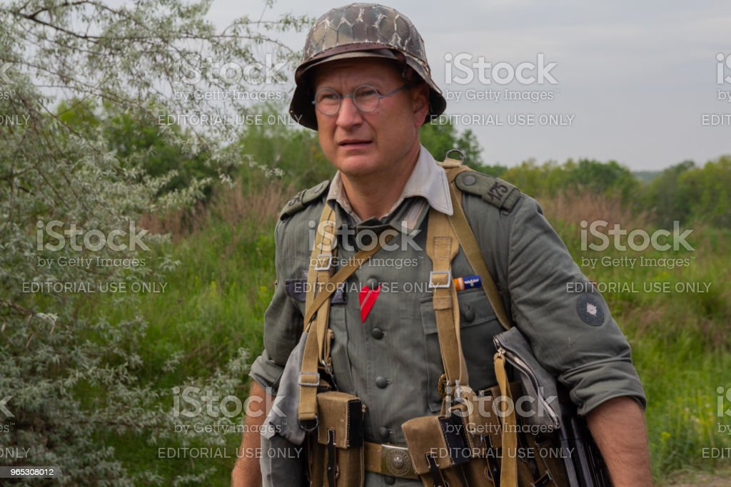 Man in the form of a Wehrmacht soldier at the historic reconstruction on the anniversary of victory in the Second World Waraa royalty-free stock photo