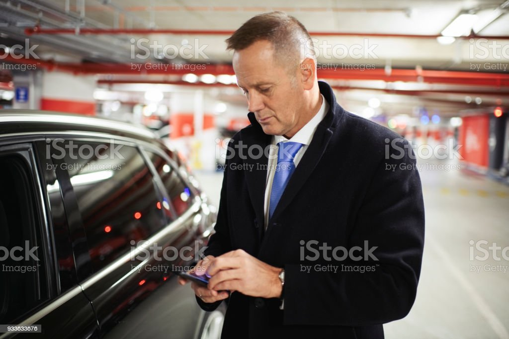Man in the garage stock photo