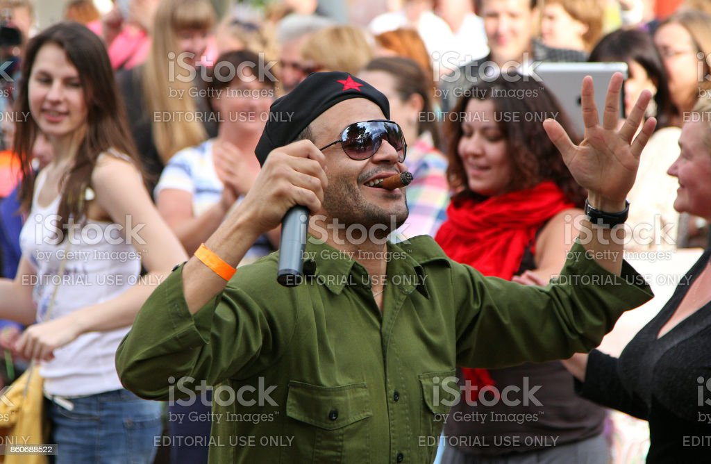 Man in the image of Che Guevara at the street festival stock photo