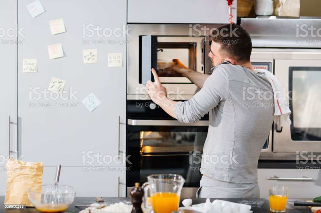 Man in the kitchen stock photo