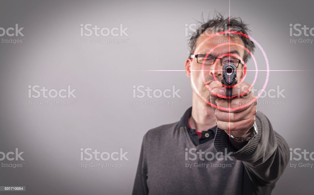 Man in the mid forties with a gun stock photo