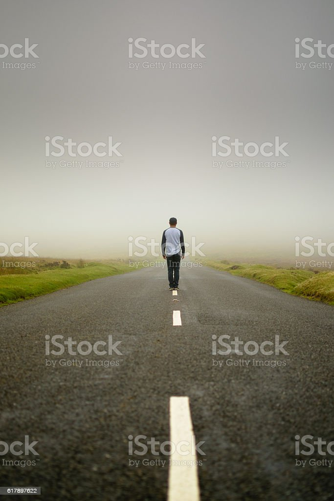 Man in the middle of the road stock photo