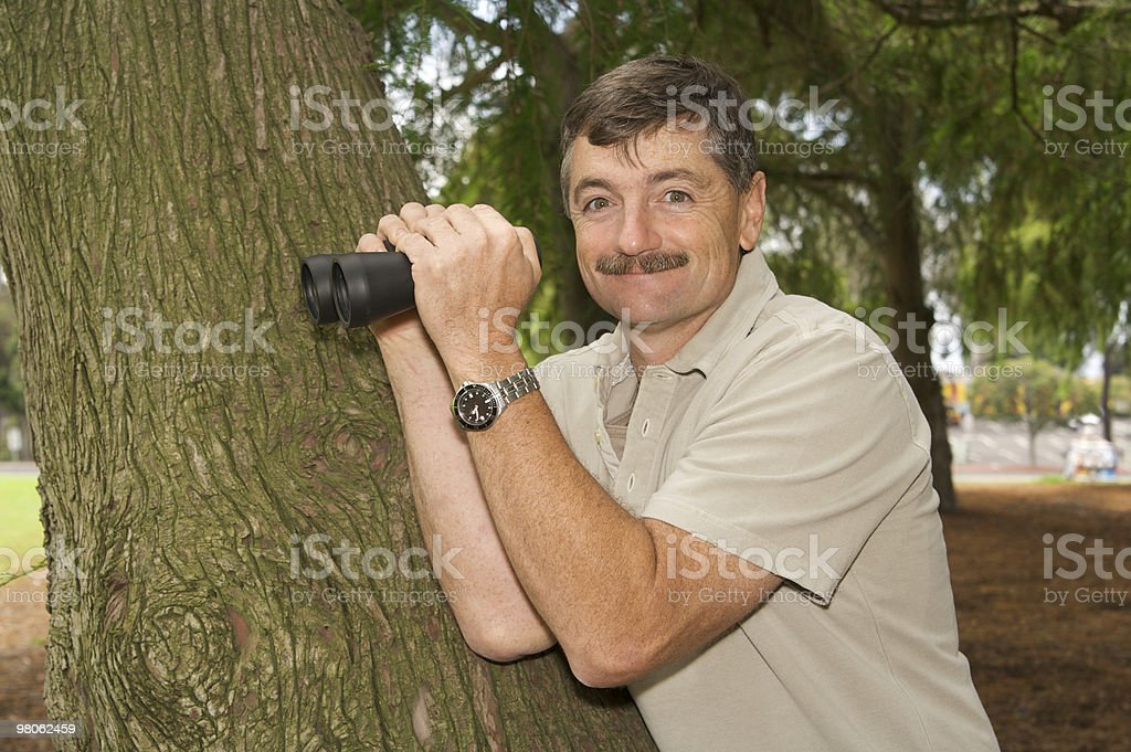 Man in the Park with Binoculars royalty-free stock photo