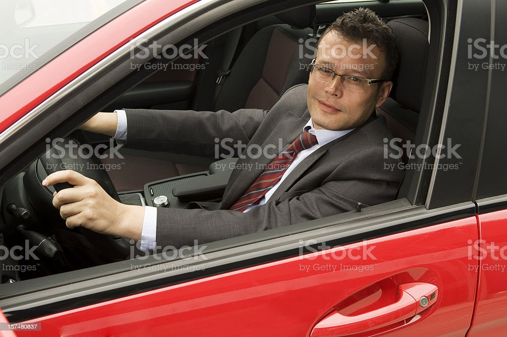 Man in the red car royalty-free stock photo