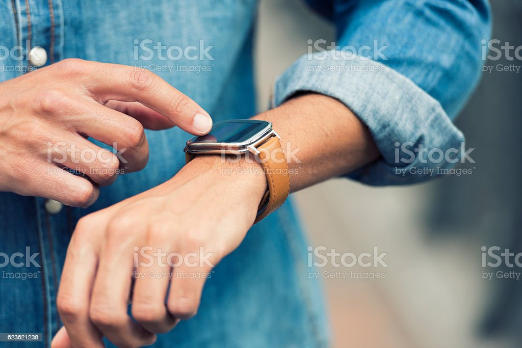 Man in the street using his smart-watch app. Urban background – Foto