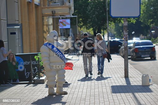 Pyatigorsk, Russia - May 9, 2017: The man in the suit of a Bibendum on the street. Bibendum (Michelin Man) is a symbol of the Michelin tire company. Advertising in Pyatigorsk